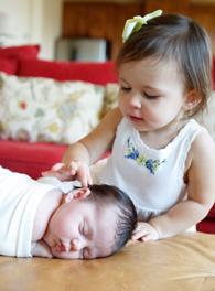 newborn and sister