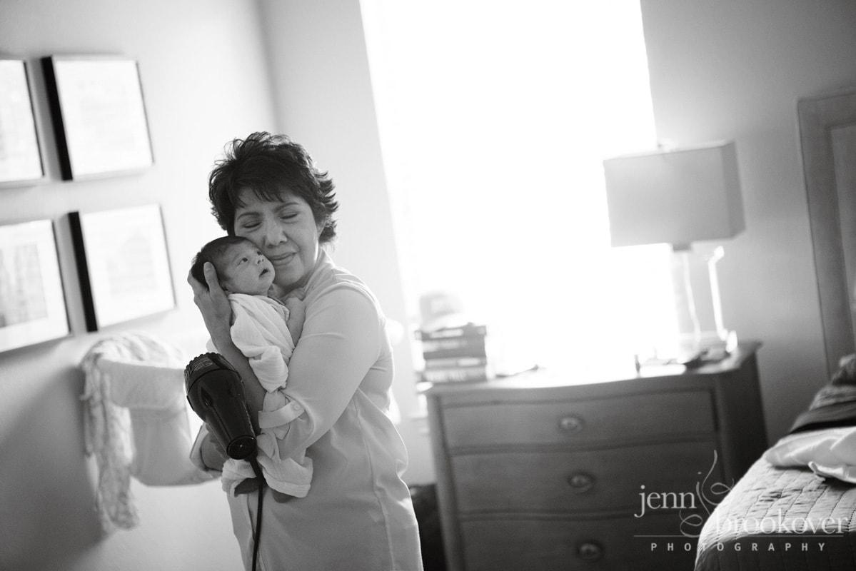 newborn snuggling with grandma at home in San Antonio