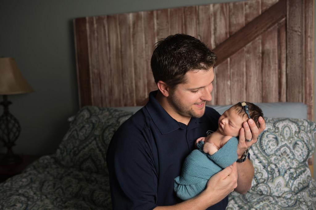 newborn with dad at home in San Antonio, Texas