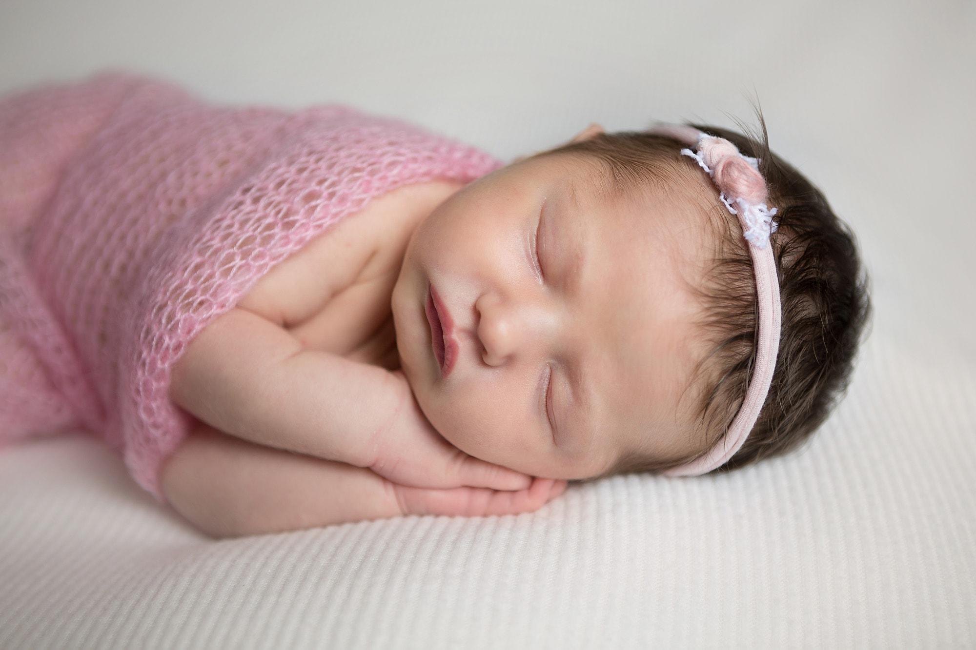 newborn portrait in pink baby girl close up in San Antonio