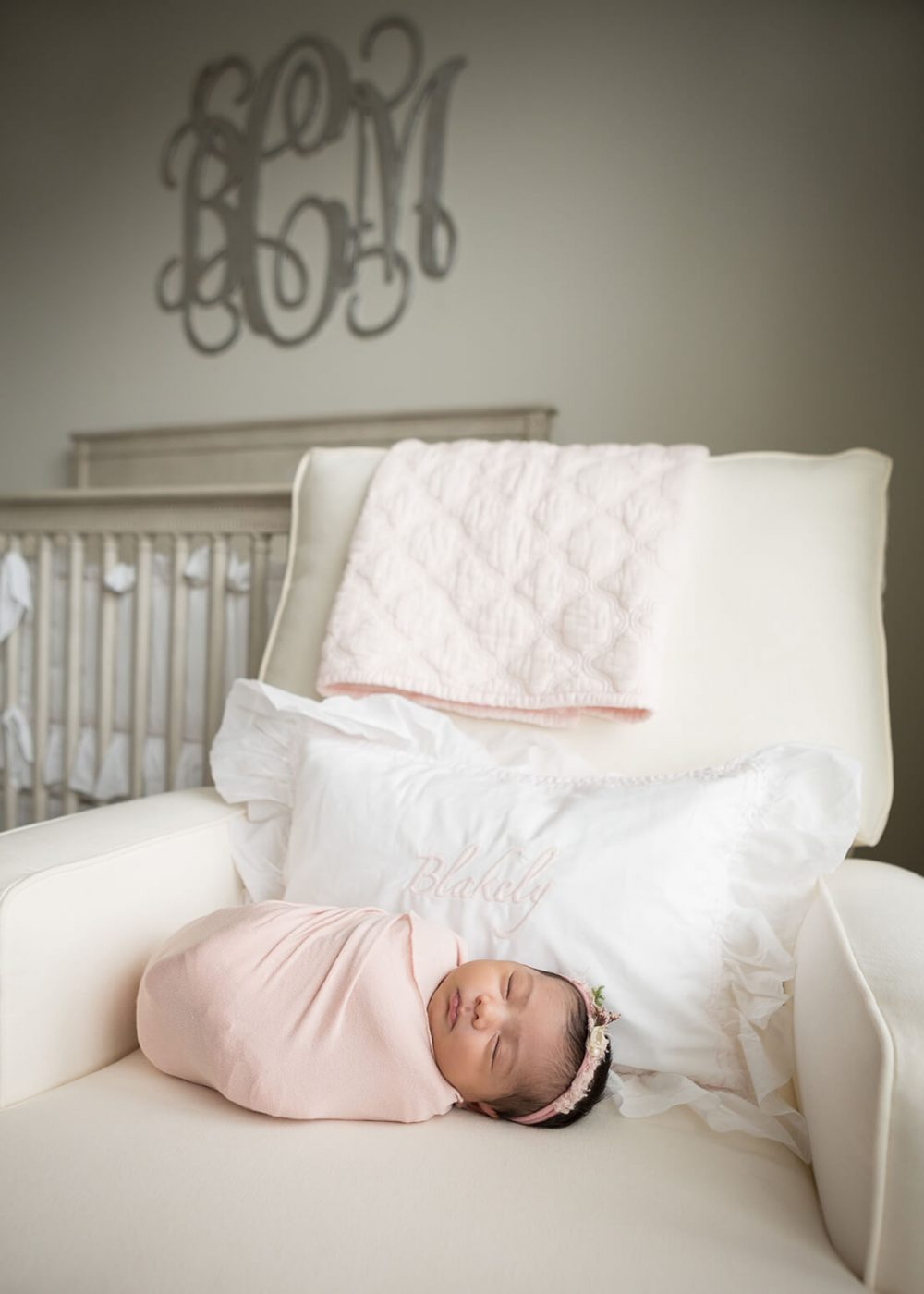 San Antonio newborn photographer portrait of a newborn girl at home in pink and gray