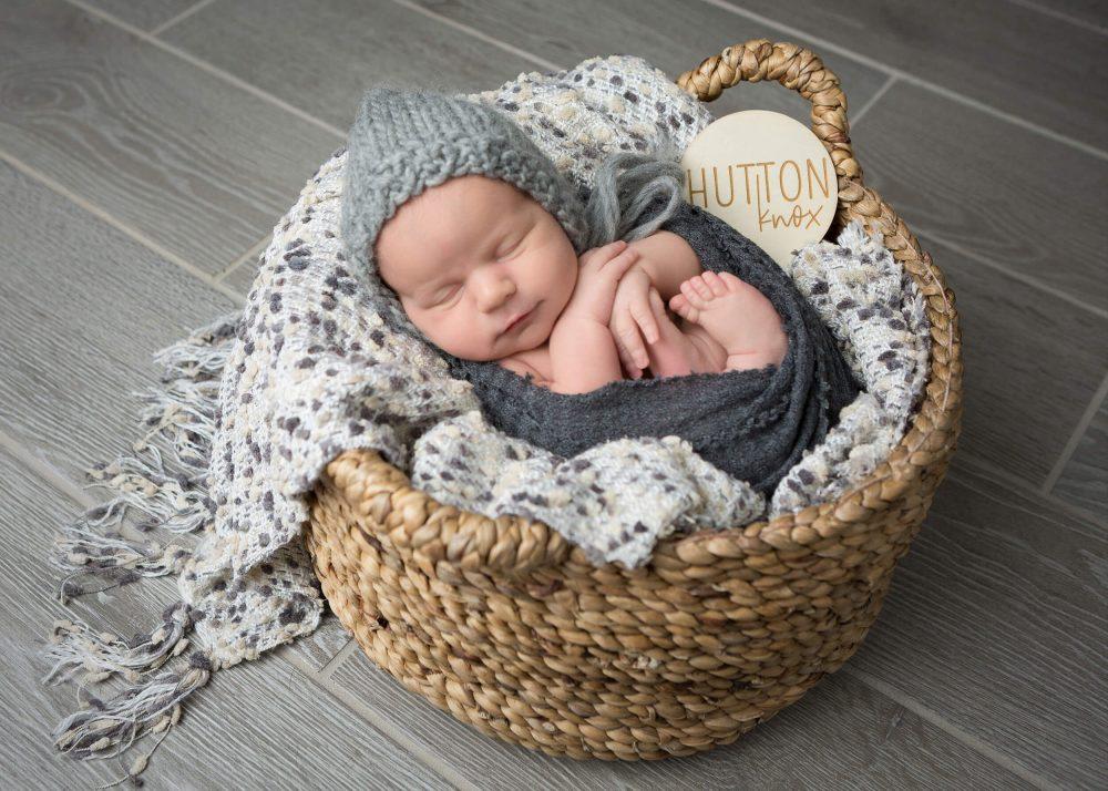 newborn boy gray hat wrapped during photo session San Antonio, Texas